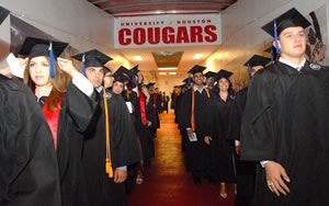 Bauer students walk into Hofheinz Pavilion, ready to become UH Cougar alumni and college graduates, during the Undergraduate Programs Commencement.