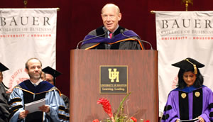 Houston Mayor Bill White, center, addresses graduates as UH Bauer Dean Arthur Warga, left, and Associate Dean for Programs and Administration Latha Ramchand listen.