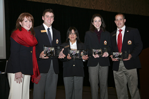 PES graduate Jessica Bondurant, second from right, stands with her classmates and teammates, who placed third in a national sales team competition. Pictured (from left) are PES clinical professor Amy Vandaveer, Jonathan Page, Alisa Hemker, Bondurant, and Jason Evans.