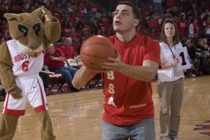 A member of the Hispanic Business Students Association prepares to sink a basket.