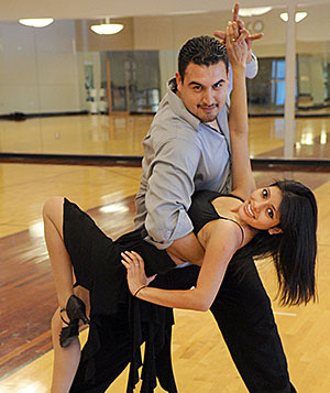 """Top Form. Entrepreneurship junior Andrea De La Torre gets """"dipped"""" by Saulo Gayosso, vice president of the Latin Fever Dance Company."""