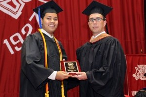 Bauer Alumni Association president Matthew Houston, right, gives Mohammed Potrik the Spring 2009 Outstanding Undergraduate award.