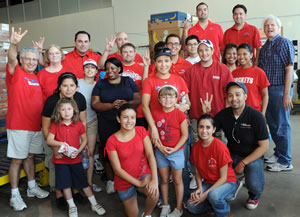 Volunteering was a family affair at the Bauer Alumni Association's first-ever Alumni Day of Service, held in June at the Houston Food Bank.