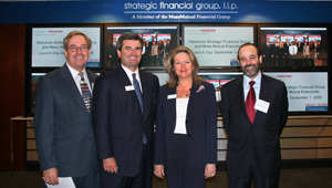 In sponsoring the video news wall at Bauer's Melcher Hall, Strategic Financial Group (SFG) has solidified its strong relationship with the College. From left, shown celebrating the partnership at a gathering in September are John O'Dell, Director of Alumni Development, Bauer College; J.K. McAndrews, President of SFG; Susan Tasson, Recruiting Director for SFG; Dean Arthur Warga, Bauer College.