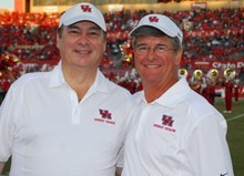 Guest sideline coaches Randy Giles, CEO for UnitedHealthcare, and Richard G. Rawson (BBA '72), president of Insperity and chairman of the UH Bauer Dean's Executive Board, were on the field during the Oct. 24 Homecoming game vs. SMU, which UH won, 38-15.