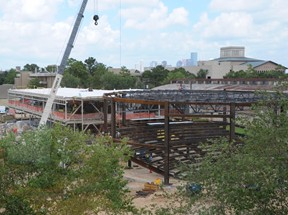 Construction of Cemo Hall has gone vertical, with steel frames erected for the building and lecture hall.