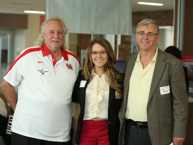 Entrepreneurship senior Sasha Volguina (center) meets with alumni Dave Billings (BBA '70) (left) and Marc Palmer (right) during the Gold and Silver Cougar Celebration on April 25.