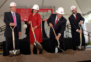 "UH Board of Regents Chair Welcome Wilson, UH President Renu Khator, UH alumnus Michael J. Cemo, and Bauer College Dean Arthur D. Warga ""turn the dirt"" at the groundbreaking ceremony for Michael J. Cemo Hall."