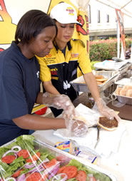 Wolff Center students prepare burgers for hungry customers at the 2008 BurgerFest competition.