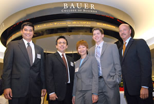 Gold Medal Win. Bauer team's John Keeton, Mauricio Franco, Quyen Nguyen and Joe Corkin with Men's Wearhouse CFO Neill Davis.