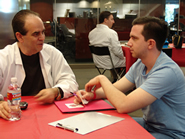 Alumni Resume ER doctor Michael Spartalis offers patient a prescription for a healthy resume.