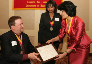 A Global University. UH President Renu Khator, right, was inducted as an honorary member of Phi Beta Delta, an honor society for international scholars, by President Brent Spraggins, who is assistant director of prebusiness and special programs at Bauer, and Anita Gaines, national Senior Vice President of Phi Beta Delta, director of the International Students & Scholar Service Office and Phi Beta Delta chapter coordinator at UH.