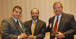 Bauer College Dean Arthur Warga, center, and Associate Dean Bob Casey present Mario Cantu, left, with the Ted Bauer Leadership Award.