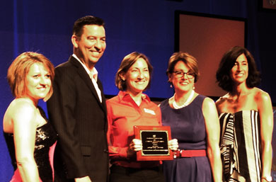 Jamie Belinne, center, receives the 2013 NACE Innovation Excellence in Diversity Programming Award.