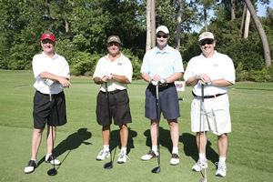 Administaff president Richard Rawson ('72), far left, led his foursome throughout the course at Champions Golf Club.
