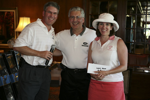 Bauer Alumni Association board member Trey Wilkinson ('92, MBA '02), left, Golf Committee co-chairman Oscar Gutierrez ('79, EMBA '94), and Kimberly Wilkinson (BBA '93) celebrate the success of the 2008 Ted Bauer Golf Classic.