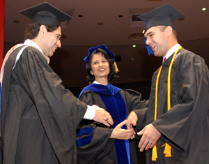 Cougar Spirit. Cougar Pride. Jeremy Rincon ('08) receives his diploma from his father, AJ Rincon, at the Spring 2008 Commencement as UH President Renu Khator watches.