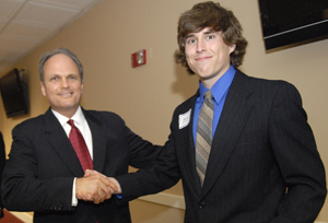 David Walker Grimes, the University's youngest graduate for Spring 2008, receives an Academic Excellence Award from board member Kenny Grace ('85) at the Accounting Advisory Board Awards Banquet.