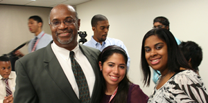 Professor George Gamble, left, provided insight into the programs at UH Bauer College for the high school students participating in the camp, including Tabitha Delley, center, and Evelyn Escobedo.