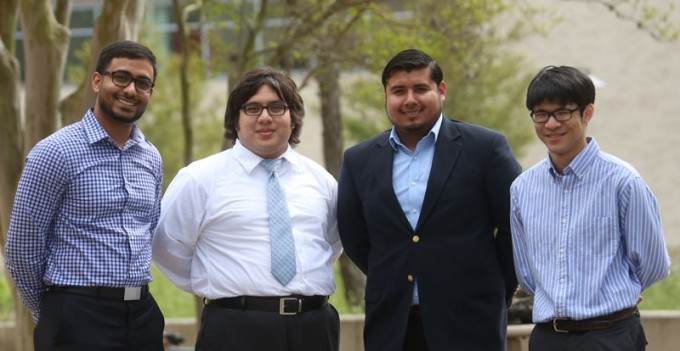 Team members (from left) Syed Ali, Wilbur Rodriguez, Adriel Negrete and An Vo, worked with Crossroads, a program that fosters positive mentoring relationships between youth and volunteers in the Houston area, by helping them create a website that met the organizations needs.