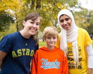 Bauer MBA Candidates Lara Machemehl and Raiya Al Salmi organized a faculty vs. students kickball game to raise money for Teague Cox, center, who suffers from brain cancer. The money raised at Bauer College will allow Teague to go deep sea fishing with his family during a Make-A-Wish Foundation event. See more photos at whereawesomehappens.com.