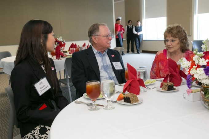 Brandee Chevanintakul, Roger Jeffery, Jr. and Diane Wenzell share lunch and memories of studying business at the University of Houston during the 2015 Gold and Silver Cougars Luncheon event.