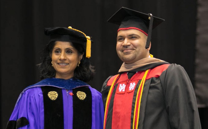Bauer College Dean Latha Ramchand and MS Finance Outstanding Student Ibrahim Nasar pose for a photo on stage during the spring 2015 convocation ceremony. See more photos at whereawesomehappens.com.